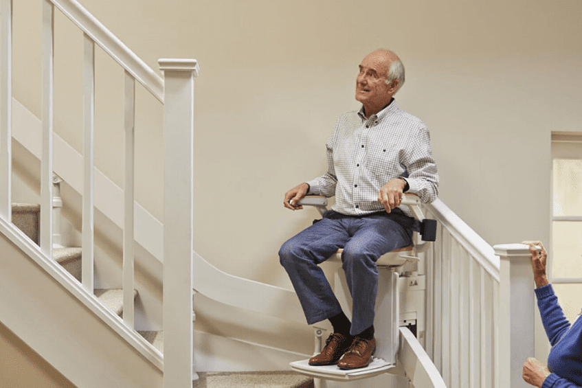 Man riding Stairlifts